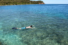 Man snorkelling. One man snorkelling in Fiji stock photography