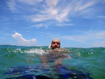 A man snorkling in the ocean. With blue fins and mask Stock Photography