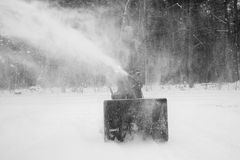 Man Snow Blowing Driveway stock photo