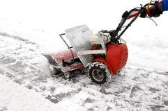Man and a snow blowing machine Stock Photo