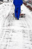 Man and a snow blowing machine Royalty Free Stock Photography