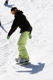 Man snow boarding Stock Photos