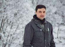 Man in a snow-covered park Stock Images