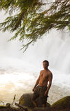 Man in Snow Creek Falls Royalty Free Stock Photography
