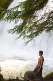 Man in Snow Creek Falls Royalty Free Stock Image