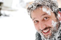 Man in snow, face fun Stock Images
