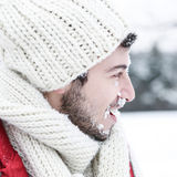 Man with snow in face at snowball fight Royalty Free Stock Image