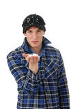 Man with snow flakes in his hand Stock Image