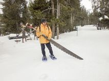 Man with snow saw, Yellowstone National Park Stock Images