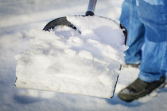 Man with a snow shovel Royalty Free Stock Images