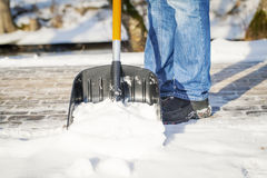 Man with a snow shovel Stock Image