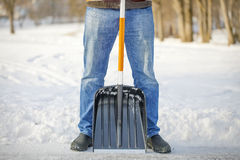 Man with a snow shovel Stock Photos