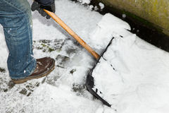 Man is snow shoveling a path Royalty Free Stock Image