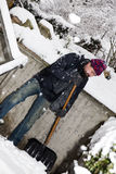 Man is snow shoveling the stairs Royalty Free Stock Photos