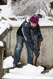 Man is snow shoveling the stairs Stock Photography