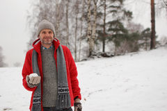 Man with snowball Royalty Free Stock Image