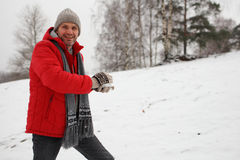 Man with snowball Royalty Free Stock Photo