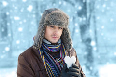 Man with a snowball Stock Images