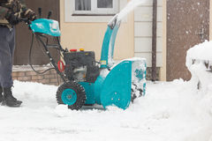Man with snowblower Royalty Free Stock Image