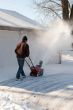 Man Snowblowing Royalty Free Stock Image