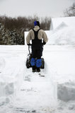 A man snowblowing snow in Connecticut Royalty Free Stock Photo
