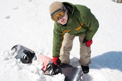 Man with snowboard Stock Images