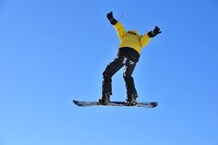 Man on snowboard jumping Royalty Free Stock Photo