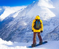 Man. snowboard winter, rides, yellow jacket Royalty Free Stock Images