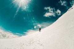 Man snowboarder freeriding at off-piste ski slope. The man descends from the top of the elbrus on a snowboard Stock Image