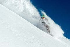 Man snowboarder is going very fast freeride in stream of snow av. Man snowboarder is going very fast freeride in the stream of snow avalanche Stock Image
