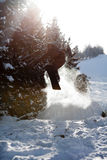 Man snowboarder jumping. Jump of man snowboarder. Backlight Royalty Free Stock Images