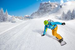 Man snowboarder riding on slope. stock image