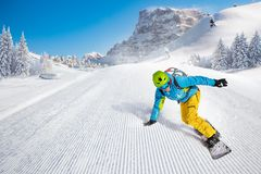 Man snowboarder riding on slope. stock photos