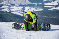 Man snowboarder  on a slope in the winter mountain Stock Photography
