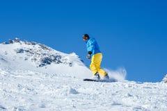 Man snowboarding Stock Photography