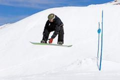 Man snowboarding on slopes of Pradollano ski resort in Spain Royalty Free Stock Photos