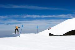 Man snowboarding on slopes of Pradollano ski resort in Spain stock photography