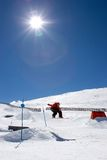 Man snowboarding on slopes of Pradollano ski resort in Spain royalty free stock images