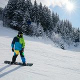 Man Snowborder in Zillertal Arena ski resort Zillertal. In Tyrol. Mayrhofen in Austria in winter in Alps. Person at Alpine mountains with snow. Downhill fun royalty free stock image