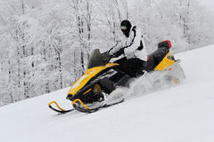 Man on snowmobile Royalty Free Stock Photos