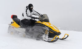 Man on snowmobile. In winter mountain Royalty Free Stock Photo