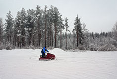 Man on a snowmobile on a skiing run Royalty Free Stock Image