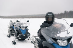 Man on a snowmobile Stock Photos