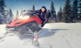 Man on snowmobile Stock Photo