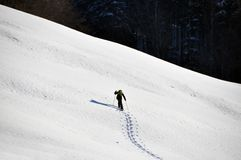 Man in snowshoe. Climbing a slope Royalty Free Stock Images