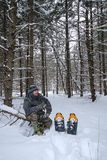 Man Snowshoeing in Forest Stock Photography