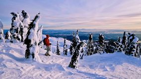 Man snowshoeing in mountains with beautiful view. Royalty Free Stock Image