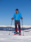 The man in snowshoes in the mountains. Stock Image