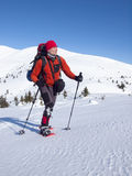 The man in snowshoes in the mountains. Stock Images