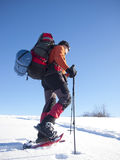 The man in snowshoes in the mountains. Royalty Free Stock Photography